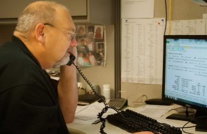 A Cemen Tech service specialist helps a customer over the phone.