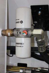 A hydraulic return filter in a volumetric concrete mixer.