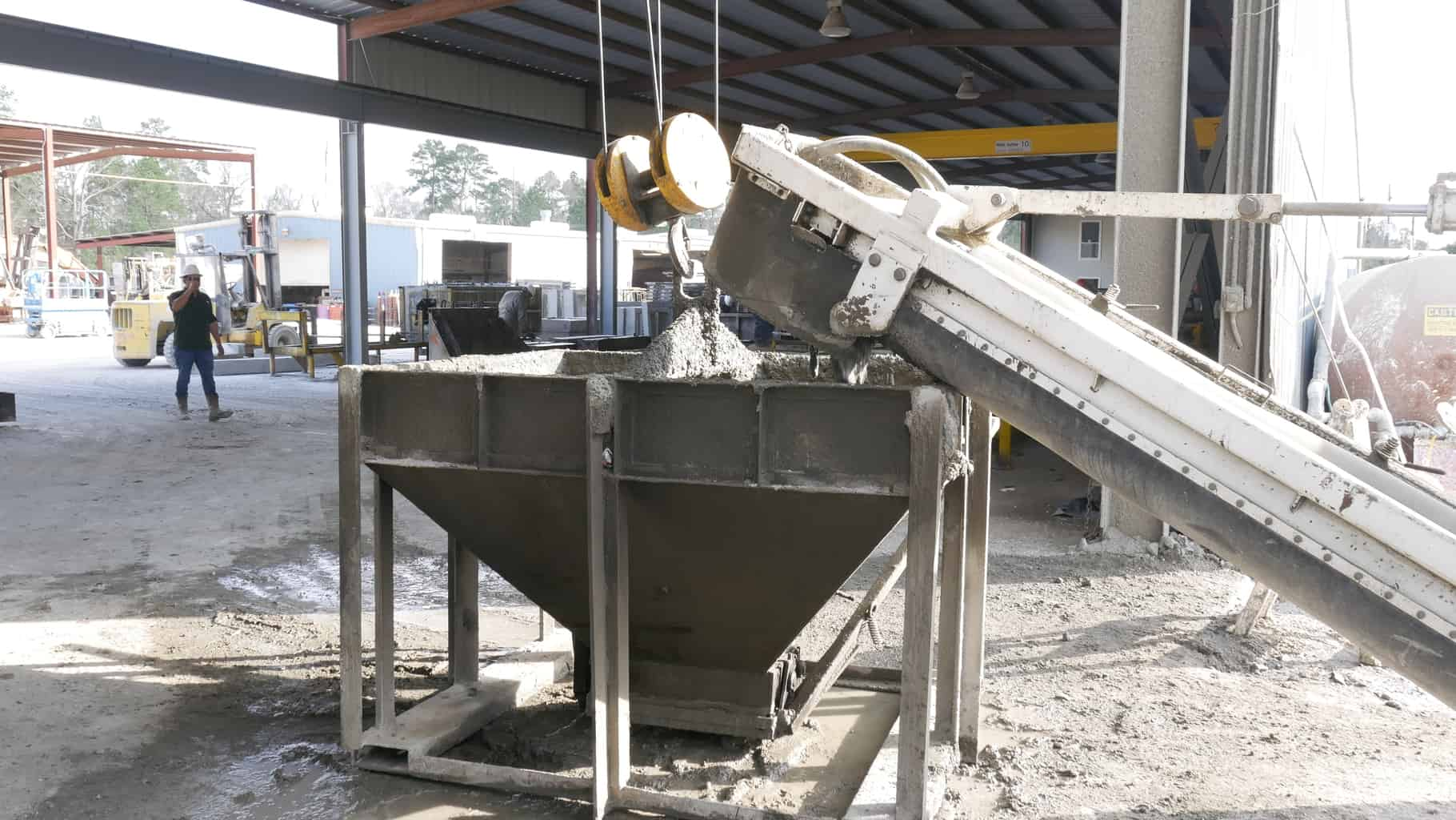 Concrete dispensing from volumetric mixer at Rock Solid Precast.