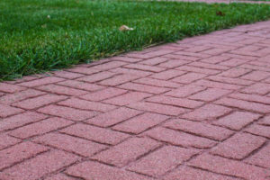 A walkway made with red decorative concrete.
