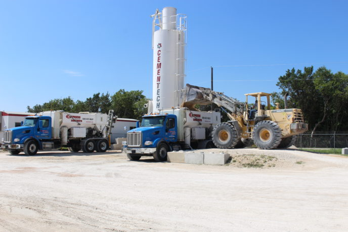 Express Metered Concrete Filling Two Trucks With Stone