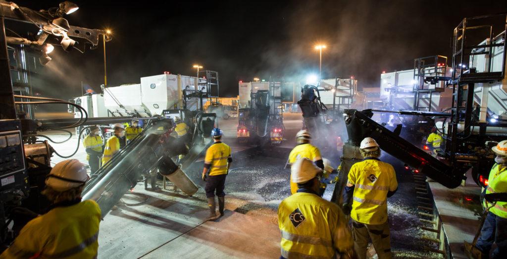 cemen tech volumetric mixers pouring an airport runway