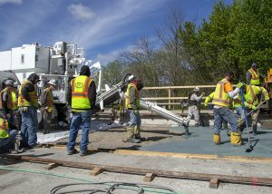 A latex modified concrete bridge deck overlay is poured with a volumetric mixer on Interstate 55 in Illinois.