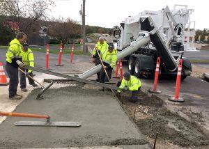 Ballwin, Missouri street department employees use a Cemen Tech volumetric mixer to repair a sidewalk.