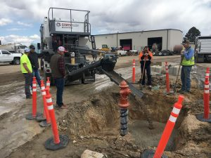 Flowable fill concrete pours around a fire hydrant installation in Colorado.