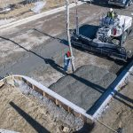 Concrete is placed with a boom pump for a hotel parking lot in suburban Denver.
