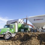 A Cemen Tech C60 volumetric concrete mixer is flanked by 2 cement silos.